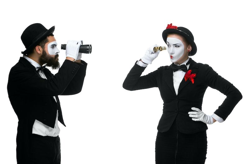 author utopia - two mimes showing mistrust for each other
